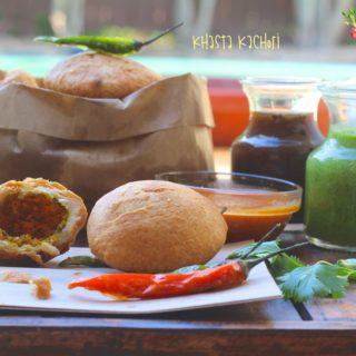 Khasta Kachori close up with a red, green chili and chutneys