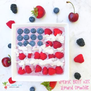 An overhead shot of square smoothie bowl with berries arranged like american flag