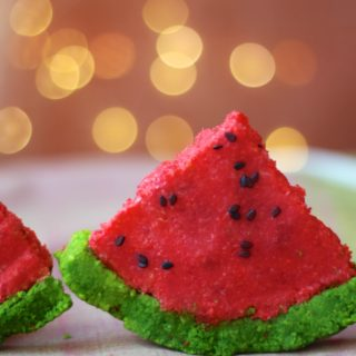a side shot of coconut fudge slice which looks like watermelon