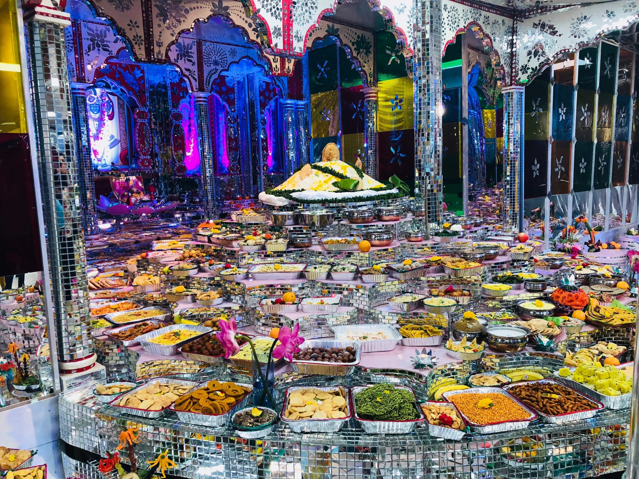 a picture of annakut celebrations with 100s of food items offered in front of God