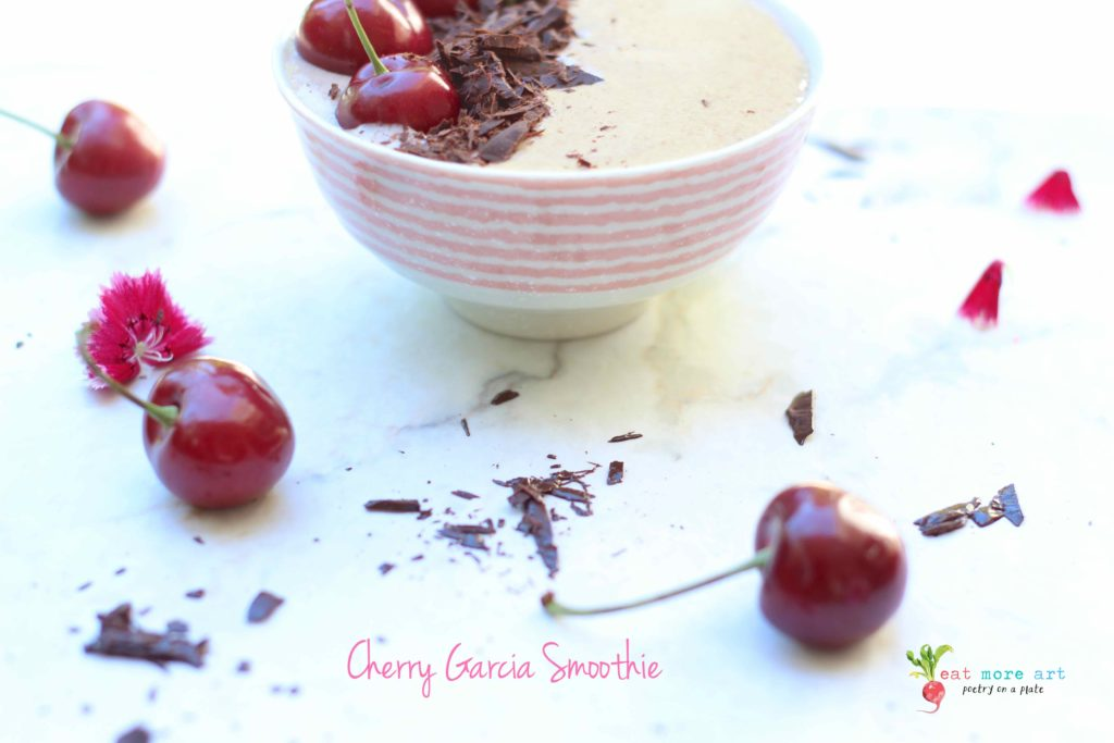 An side shot of cherry garcia smoothie bowl garnished with dark chocolate and cherries
