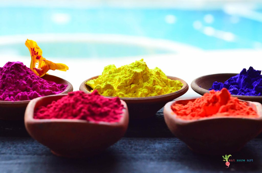 a side shot of various holi colors