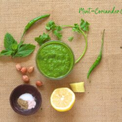 an overhead shot of mint-cilantro chutney with ingredients placed on the side