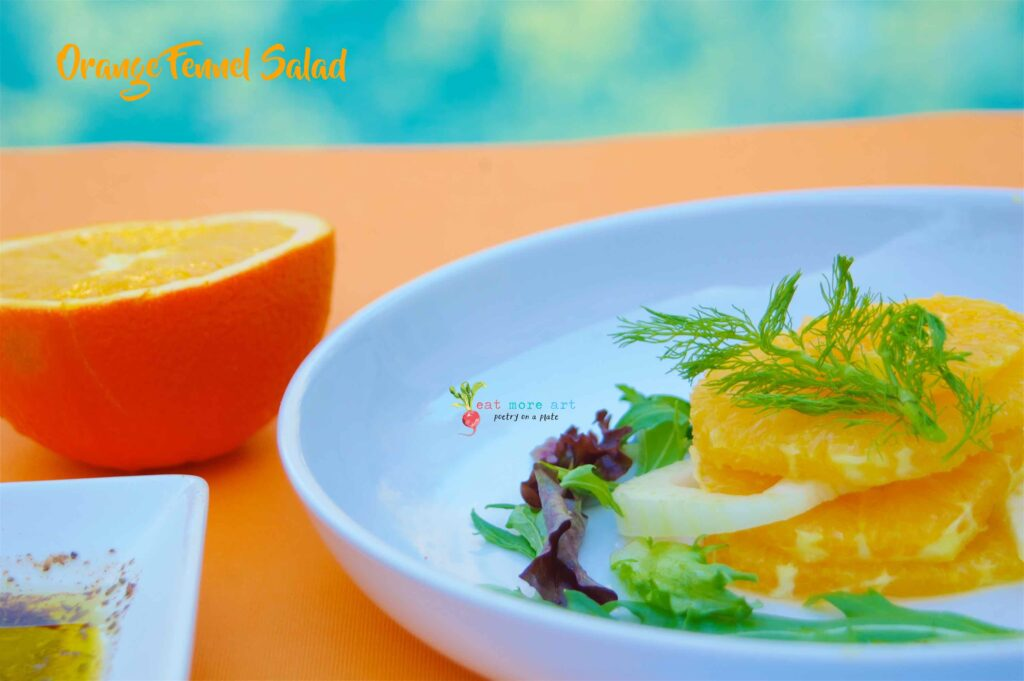 A close up shot of orange & fennel salad with greens