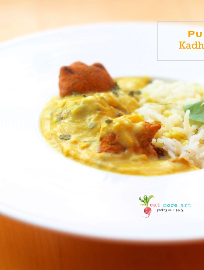 a plate of punjabi kadhi pakora