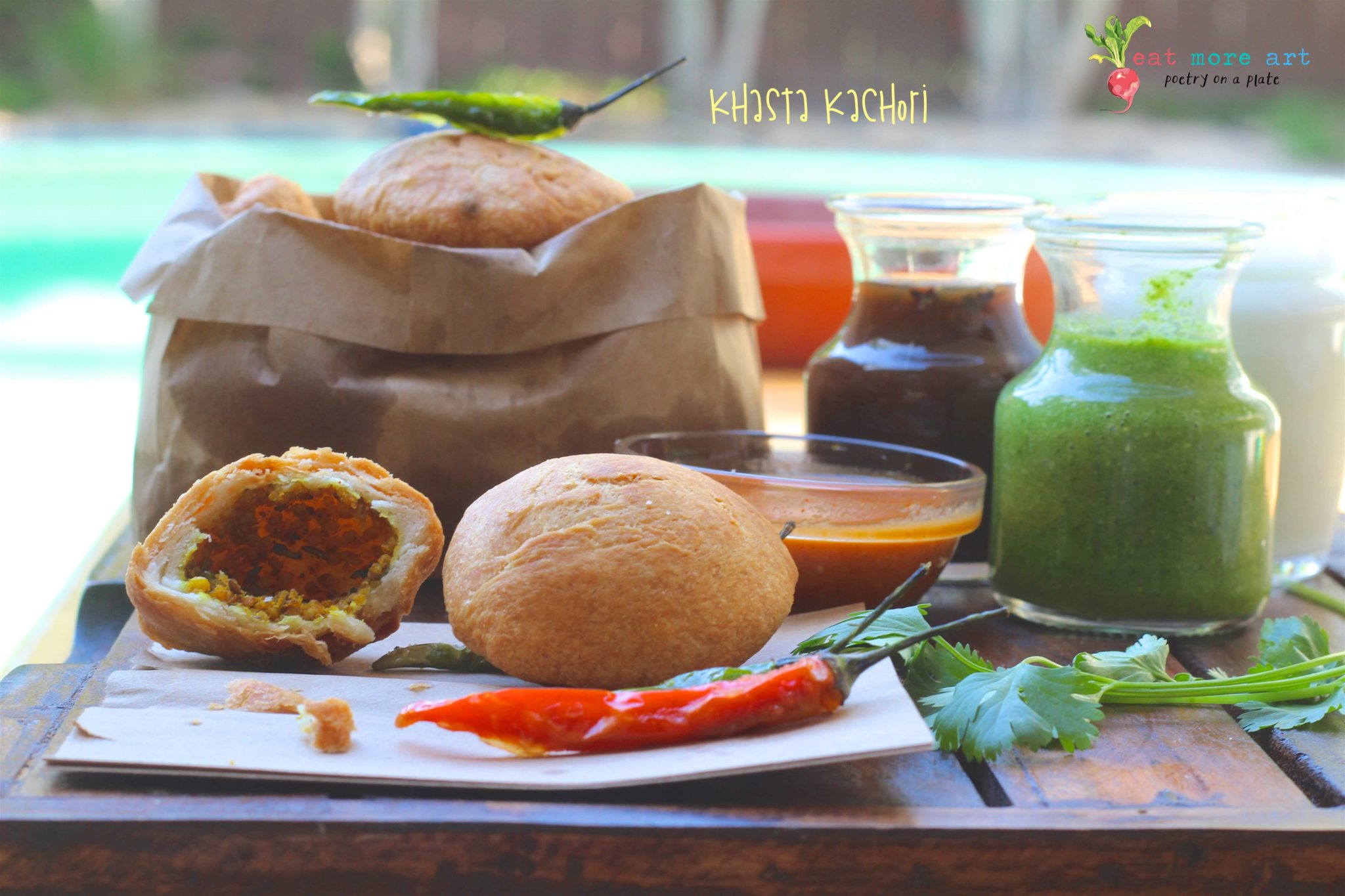 Khasta Kachori close up with a red, green chili and chutneys