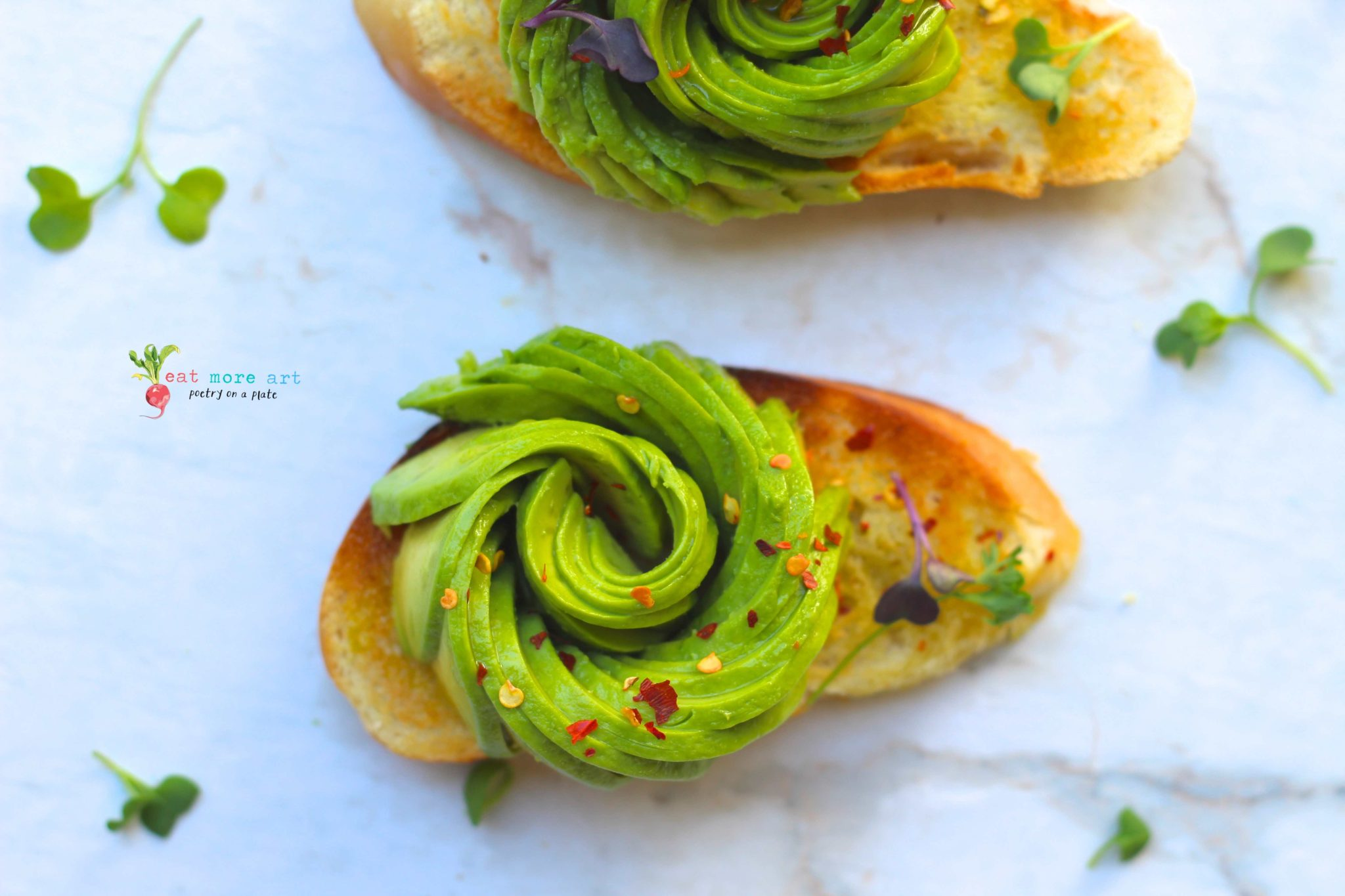 A toast topped with avocado rose