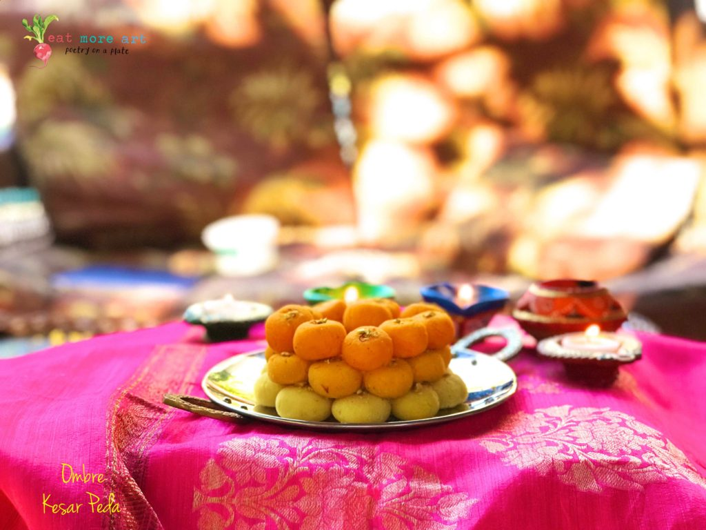Ombre saffron peda in shades of yellow and orange stacked on a plate on hot pink background