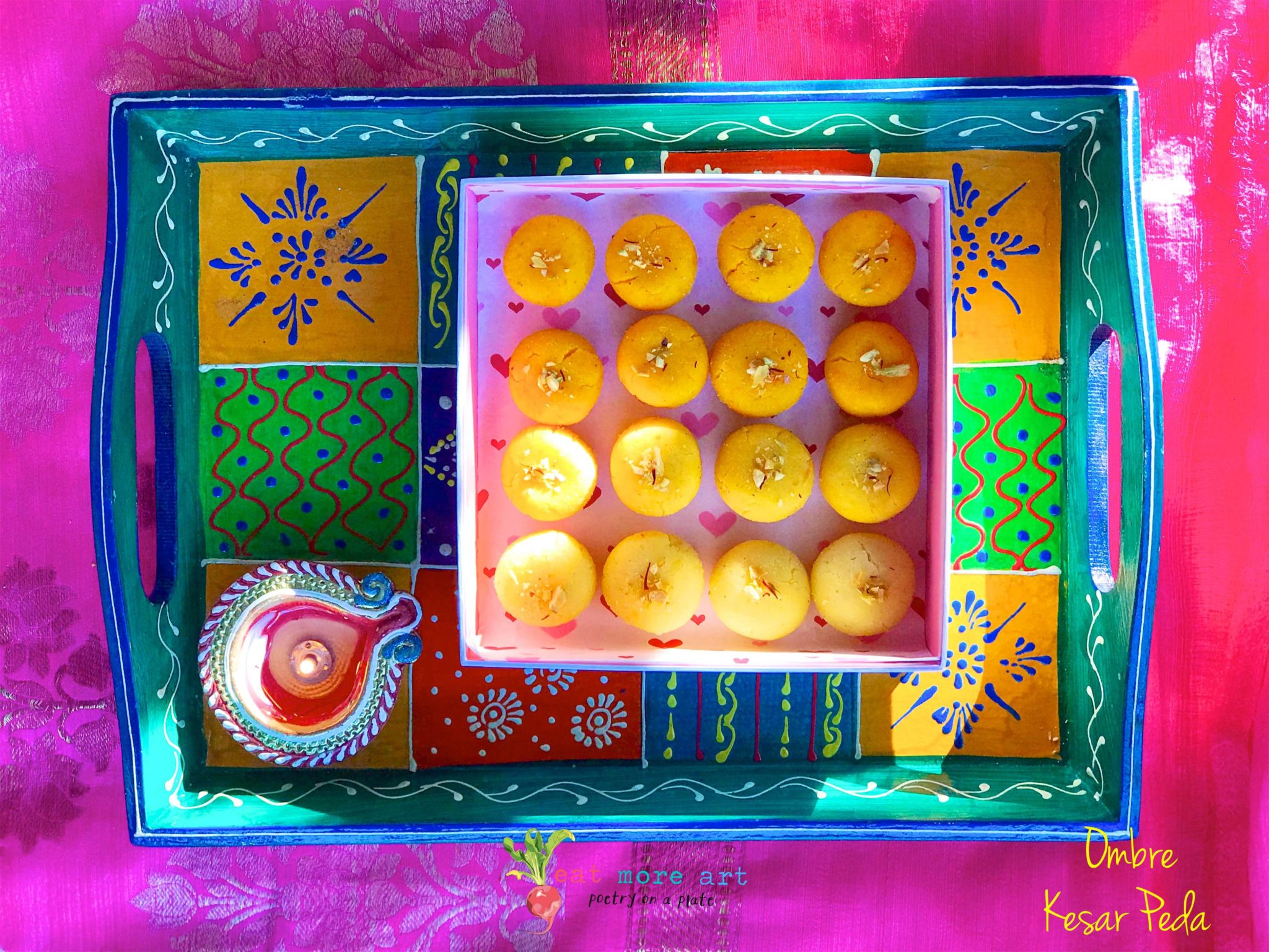 Ombre saffron peda in shades of yellow and orange arranged in a box decorative colorful tray