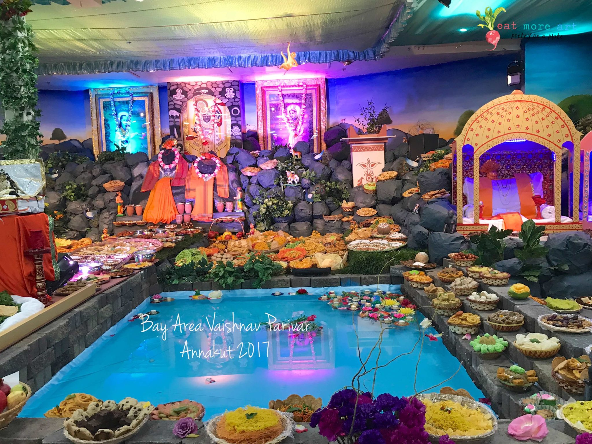 Diwali annakut food offered in a temple with hundreds of varieties of food tray in front of God