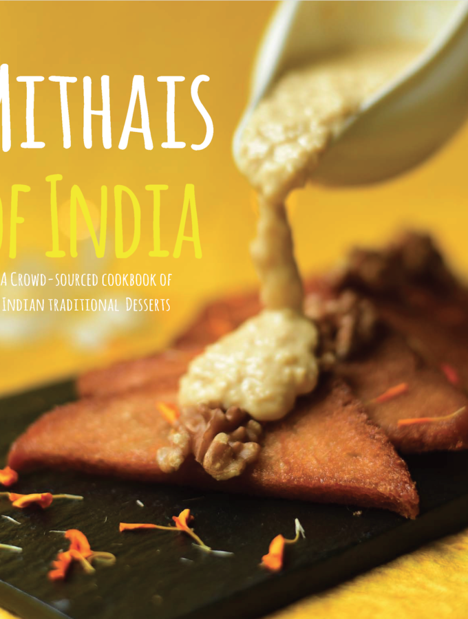 Yellow color 'Mithais of India' book cover with dessert picture