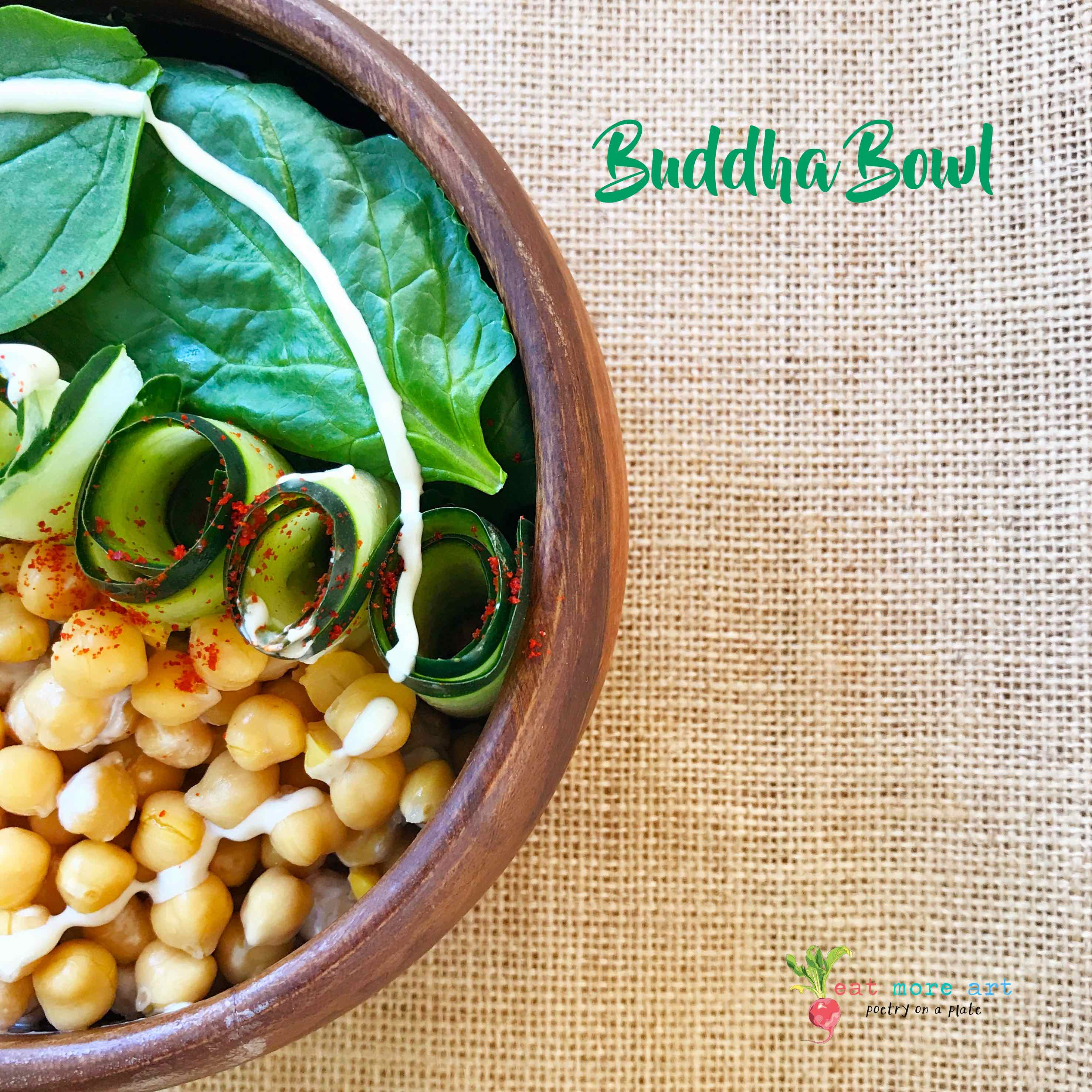 An overhead shot of Buddha Bowl | Spinach, Chickpeas, Cucumber with Tahini dressing