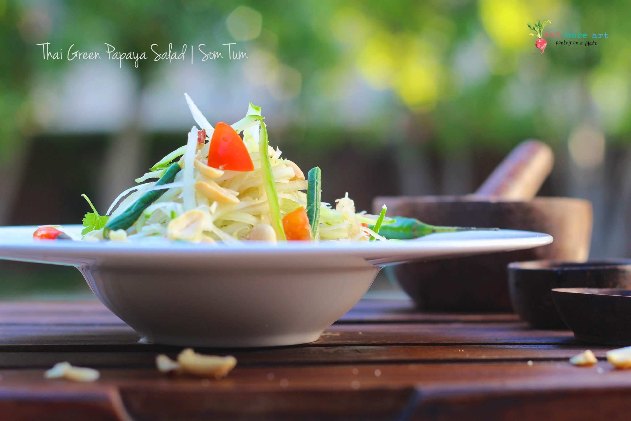 A side shot of Thai green papaya salad