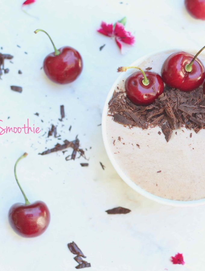 An overhead shot of cherry garcia smoothie bowl garnished with dark chocolate and cherries