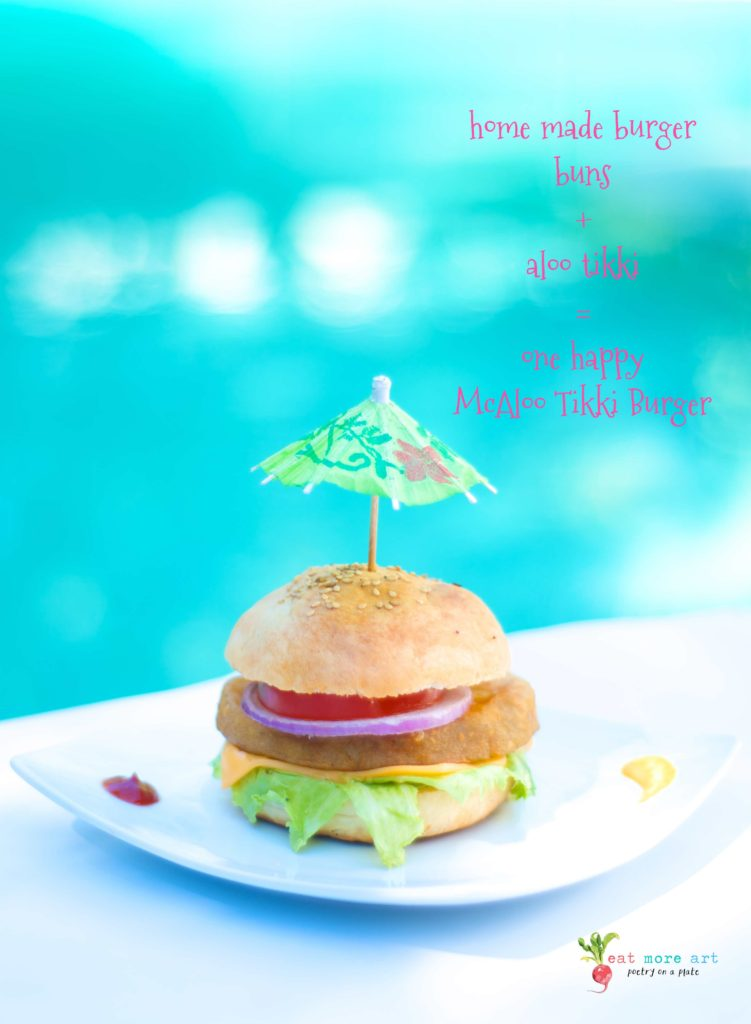 A veggie burger with an umbrella shaped toothpick, by the swimming pool