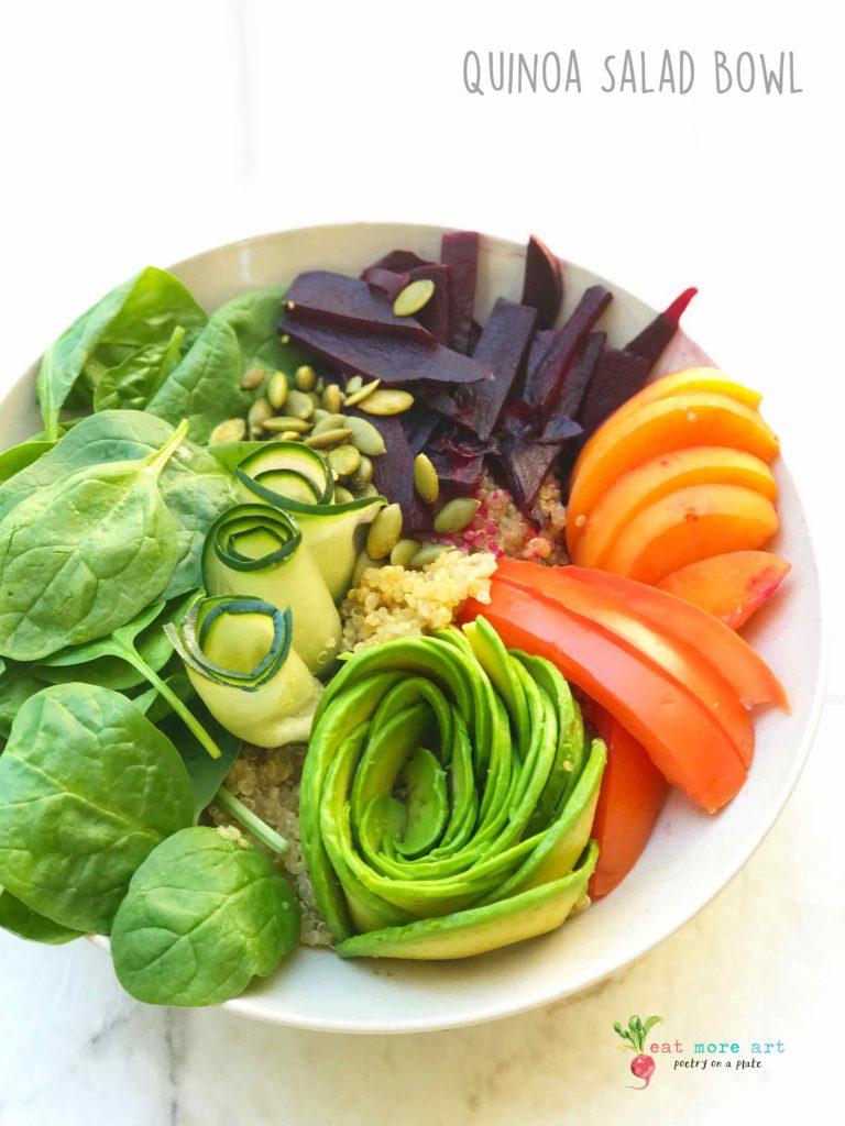 An overhead shot of vegan quinoa salad bowl with fruits and veggies