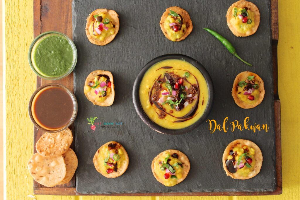 An overhead shot of Dal Pakwan bites served with chutneys