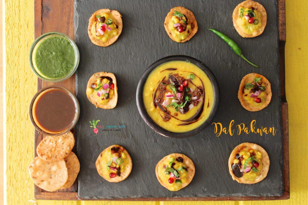 An overhead shot of Dal Pakwan bites served with chutneys
