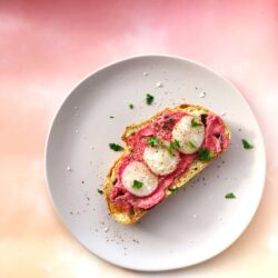 An overhead shot of Beetroot Hummus Toast topped with radishes