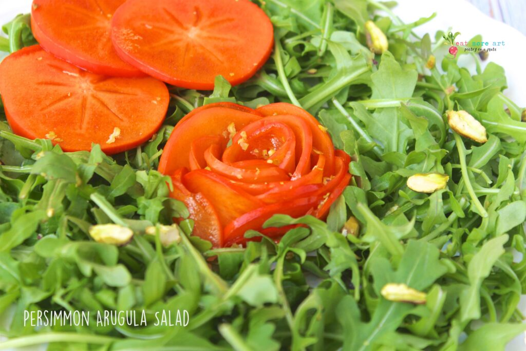 A closeup side shot of Persimmon Arugula Salad