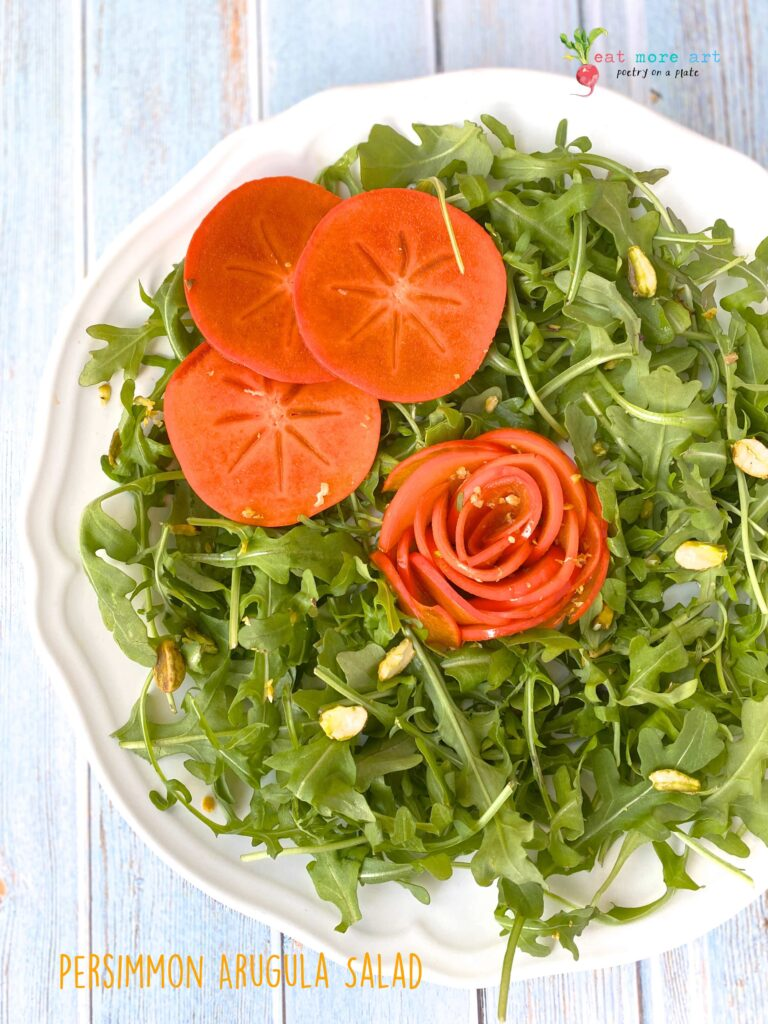 An overhead shot of Persimmon Arugula Salad