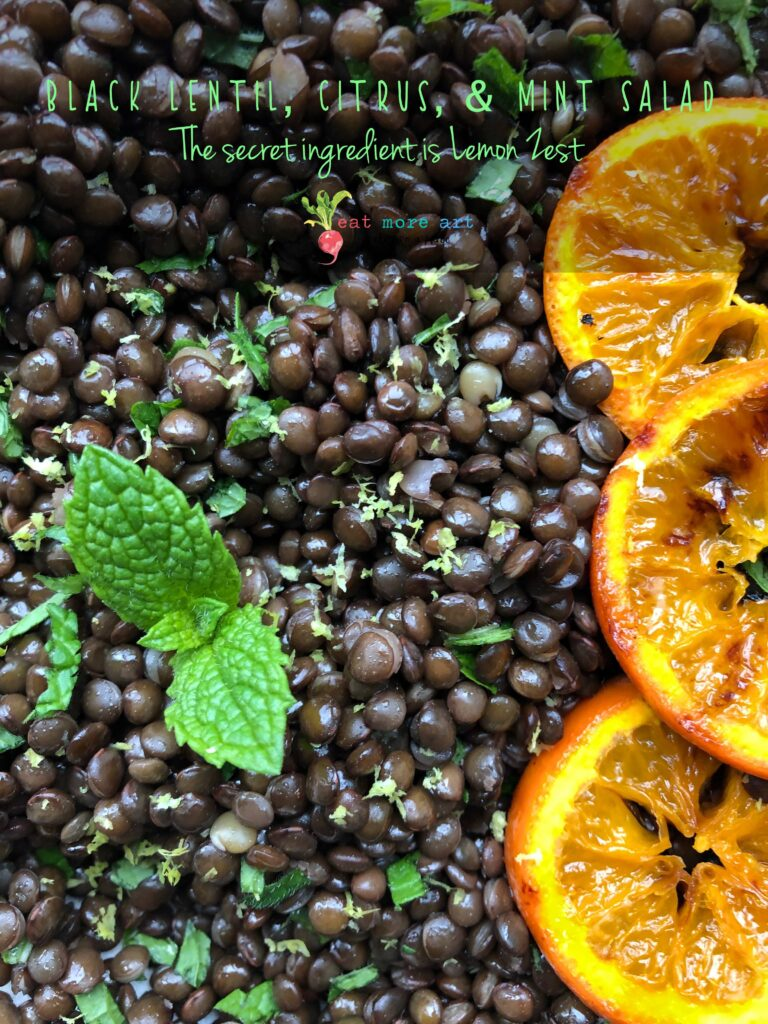An overhead shot of black lentil, citrus & mint salad