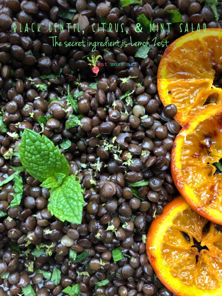 An overhead shot of black lentil, citrus & mint salad