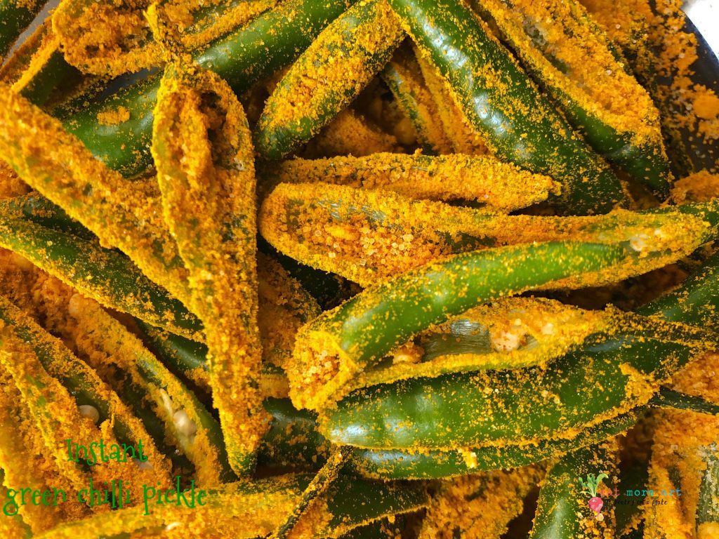 A close up shot of green chillies covered in salt and turmeric