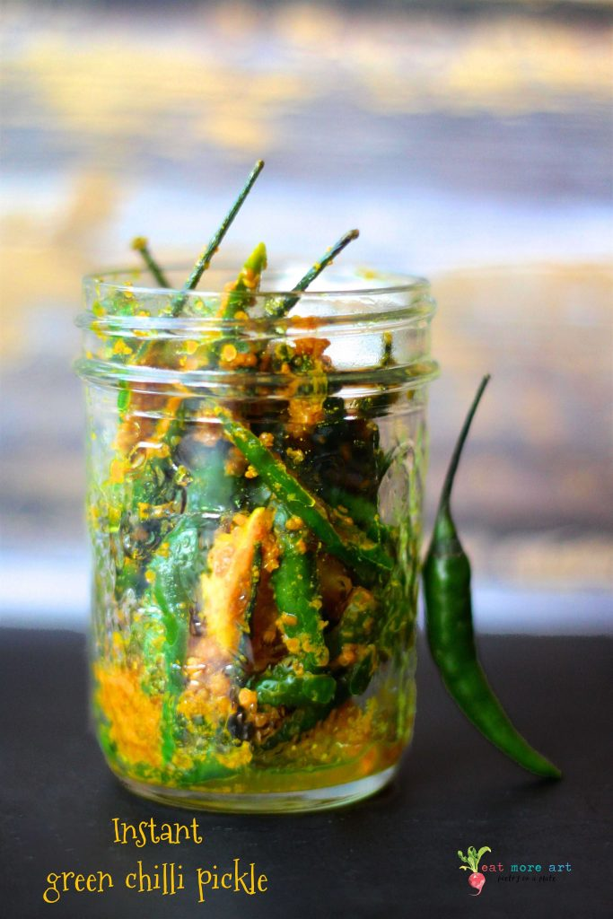 A side shot of a jar of instant green chilli pickle