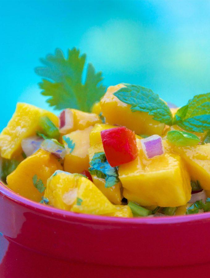 A close up shot of a bowl of mango salsa