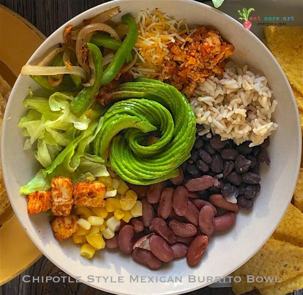 An overhead, closeup shot of chipotle style mexican burrito bowl
